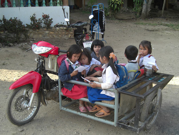 school bus made from motorcycle and sidecar