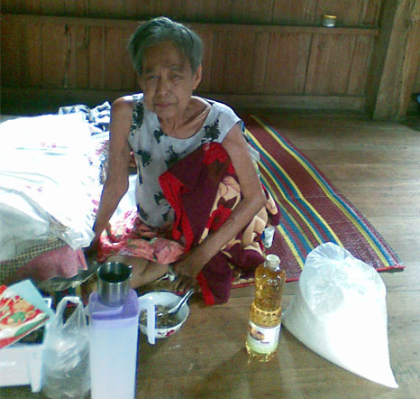 elderly woman moved to receive food aid