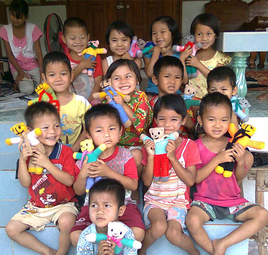 Happy children with toy bears